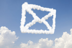 Email and mail communication concept symbol in clouds on blue sk
